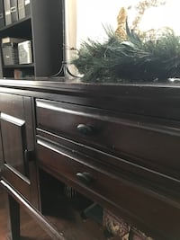 Solid wood Ashley Buffet. Perfect to paint and add new knobs to, or use as is. Does have scratches on the top, and wear. Solid piece.