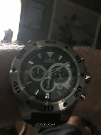round silver chronograph watch with black leather strap North Fort Myers, 33917