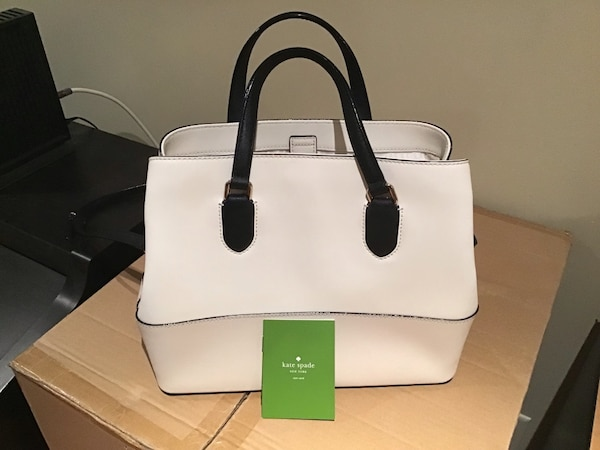 white and black Kate Spade leather tote bag