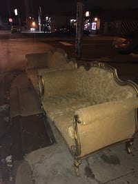 brown wooden framed brown fabric padded sofa chair