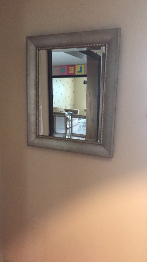rectangular mirror with gray wooden frame