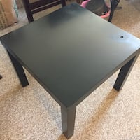 square black wooden table
