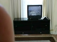 black flat screen TV with black wooden TV stand 450 mi