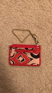 red and beige Coach wristlet