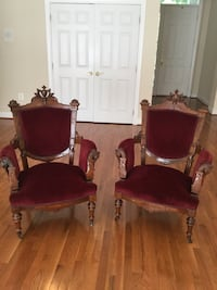 two red padded brown wooden armchairs Reston, 20191