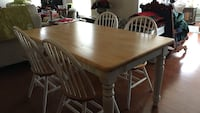 Rectangular butcher block wooden table with four chairs dining set. 60 inches long, 36 inches wide, 30 inches high, solid wood. Excellent condition Millsboro, 19966