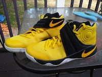 pair of yellow-and-black Nike basketball shoes Cleveland, 44108