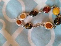 925 silver braclet with Amber and different rare stones Ask 45$ Montreal, H8S 1W4