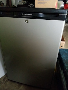 gray and black Frigidaire compact refrigerator