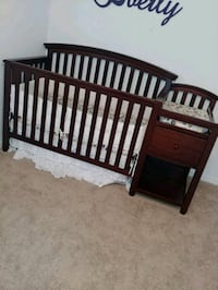 baby's brown wooden crib Tampa, 33621