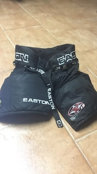 black and gray Easton protective hockey shorts