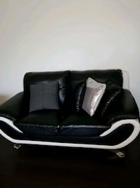 black and white leather sofa chair Abbotsford, V2S 7A2
