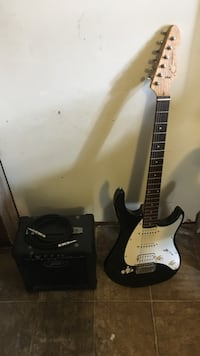 white and black stratocaster electric guitar Sunset, 70584