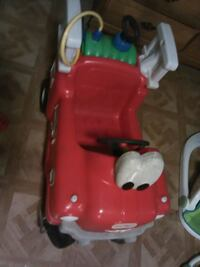 toddler's red and white Little Tikes ride-on toy car Troy
