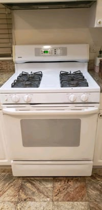Cooking range with self cleaning oven