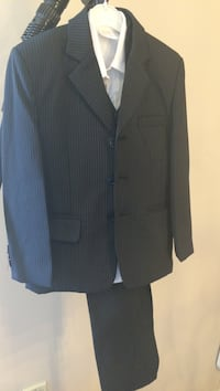 Size 7 boys black pin strip suit including white shirt size 7.comes with shirt, pants , vest, and jacket Brampton, L6S
