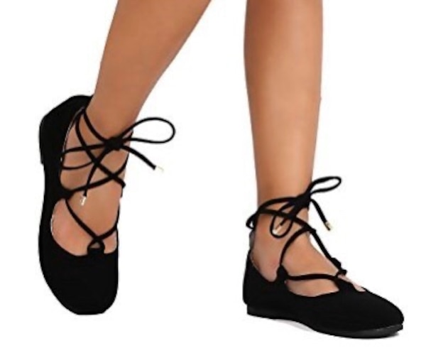 Black ballet flats that lace up the ankles. Size 12 c00ce323-4b67-42bc-a00b-ae359e02ddc8