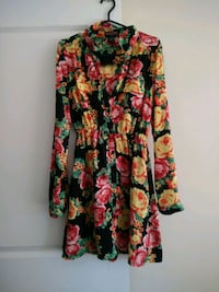 black, red, and green floral long sleeve dress