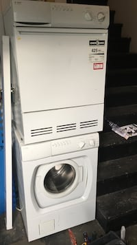 white dishwasher and white front load dryer