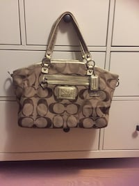 Brown coach monogram shoulder bag Mississauga, L4Z 1K9