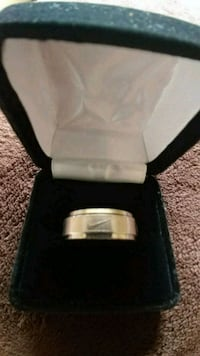 silver-colored Nike ring with box