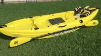 SPORT LISTING- Yellow kayak for sale. Price includes the paddle and life jacket- all new never been used.  Spring, 77373