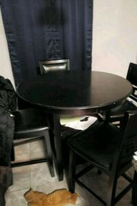 round black wooden table with four chairs dining set League City, 77573