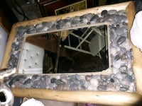 Large good quality very heavy mirror w rock border