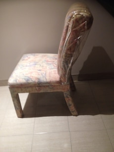 yellow, pink, and blue fabric padded chair