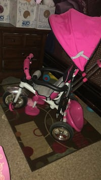 baby's pink and black trike Bakersfield, 93307