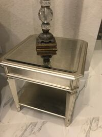 Antiqued champagne mirrored end table