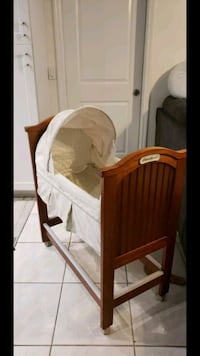 white and brown wooden crib Orlando, 32839