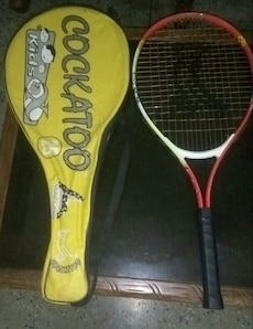 red and white Cockatoo tennis racket with yellow case
