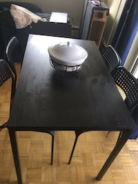 rectangular black wooden table with four chairs dining set Oshawa, L1G 4X2