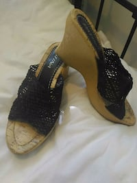 pair of black-and-brown wedge sandals Toronto, M6A 2S3