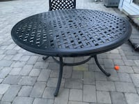 Round cast-top dining table in onyx finish