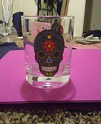 clear drinking glasses with sugar skull painted