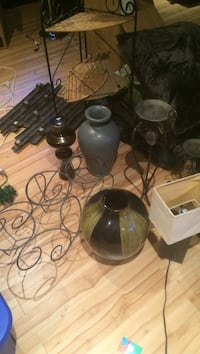 assorted candle holders and vases