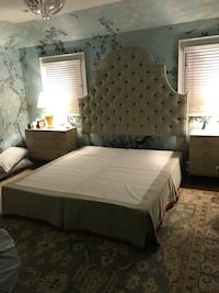 Custom King-sized upholstered blue and beige headboard, skirt and box spring