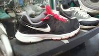 pair of black Nike running shoes Detroit, 48213