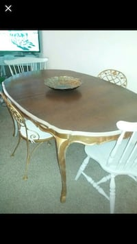 round brown wooden table with four chairs dining set null