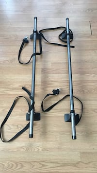 two gray-and-black car roof bars