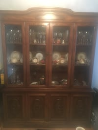 Brown wooden framed glass display cabinet Toronto, M1E 4Y1