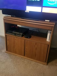 tv stand. top part swivels 180° for better view. d