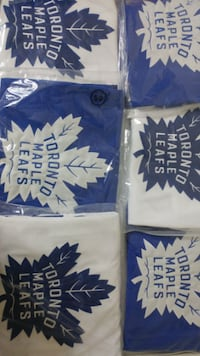 two white and blue crew-neck shirts null