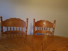 two brown wooden chairs