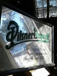 pilsner urquen mirror signage with black frame