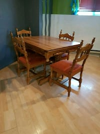 rectangular brown wooden table with four chairs di 744 km