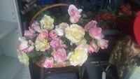 Pink & yellow roses in wicker basket, negotiable.  Bryan, 77803