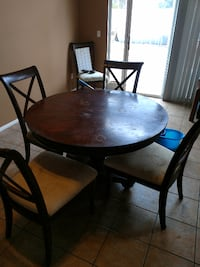 round brown wooden table and chairs dining set